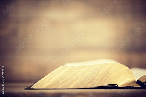 Fotografia  Holy Bible  book on a wooden background
