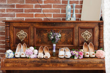 Wedding Concept. Bridesmaid High-heel Shoes And Flower Bouquets On The Vintage Brown Piano.