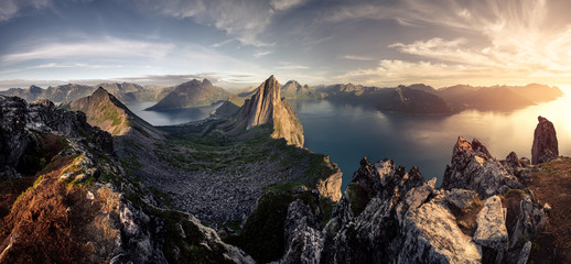 Fototapeta Mountainous panorma landscape view with huge fjords during golden sunset in Senja, Norway