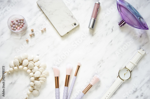Feminine accessories on a marble desk. Flat lay, top view Fototapeta