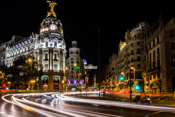 Night view of Metropolis Building and traffic light trails (Madrid, Spain)