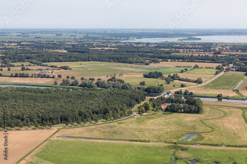 Photo Aerial view Dutch polder Noordoostpolder with woods en agricultural landscape
