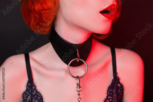 Photographie  Redhead girl on black background