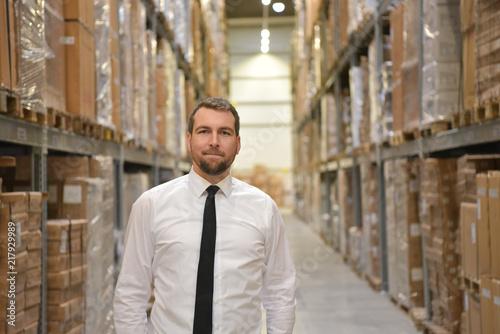 Portrait Geschäftsmann/ Manager im Warenlager einer Spedition //// Portrait of a Wallpaper Mural