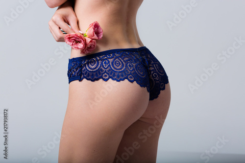 Obraz Woman wearing blue lace panties - fototapety do salonu