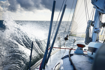 Stormy weather on the sea. A view from the sailboat's deck to the bow, Norway