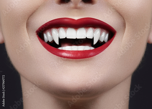 Sexy Female Vampire Lips. Monster Smile. Halloween Style with Red Blood Makeup Lip. Masquerade Look with Terrible Fags