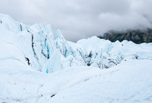A Climber Ascends The Face Of One Of The Sercacs Of The Matanuska Glacier.