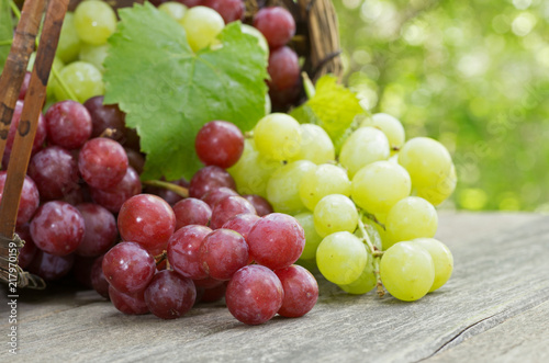 Fresh Red and Green Grapes on a Rustic Wooden Table