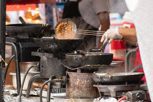 Fotografie, Obraz  Oriental chicken food made to order at outdoor festival.