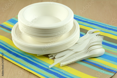 White eco-friendly disposable compostable plates bowls and cutlery on place mat Canvas Print