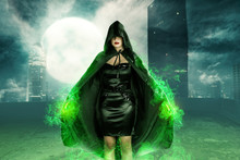 Young Asian Witch Woman Standing With Green Fire On Her