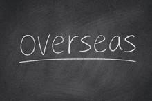 Overseas Concept Word On A Blackboard Background