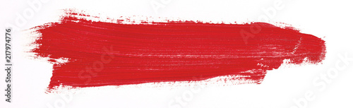 Red brush stroke isolated over white background Canvas-taulu