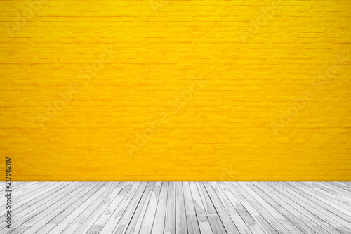 Fotobehang Historisch geb. Yellow brick wall texture with wood floor background