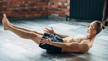 Sport And Fitness. Yoga Training For Abs Muscles Stamina And Endurance. Physical Activities For Strong Body And Healthy Mind. Man Exercising In A Gym.