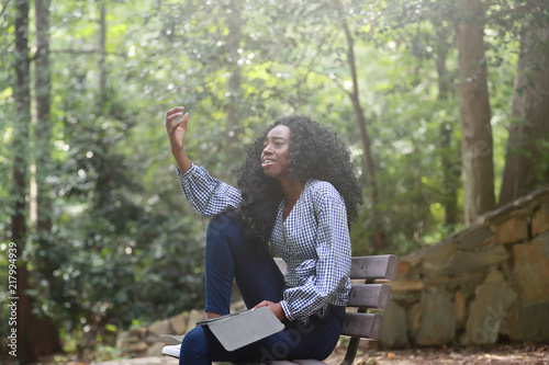 Fotografie, Obraz  Stylish black woman reading book expressively
