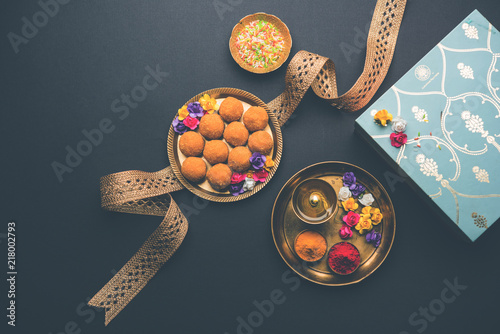 Raksha bandhan Festival : conceptual Rakhi made using plate full of Bundi Laddu sweet with band and Pooja Thali Wallpaper Mural