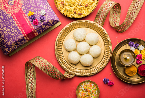 Fotografering  Raksha bandhan Festival : conceptual Rakhi made using plate full of Rasgulla sweet with band