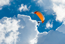 Orange Paraglider In The Blue ...