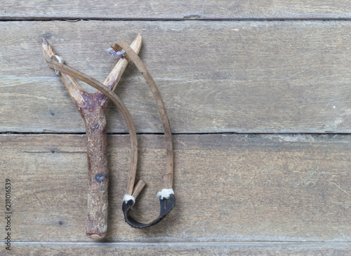Slingshot on a wooden table with copy space.