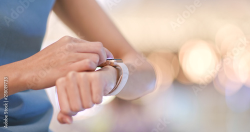 Fototapeta Woman use of smart watch inside shopping mall obraz