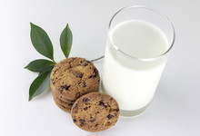 Chocolate Chip Cookies And Milk On White Background With Green Leave
