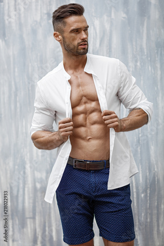 Handsome man in white shirt posing Canvas Print