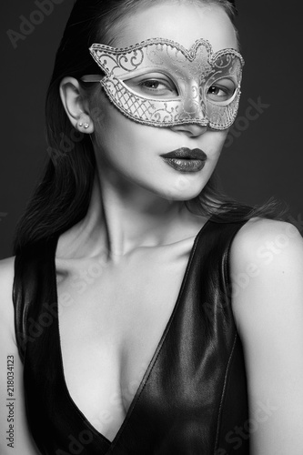 Photo  girl in Mask and sexual leather dress