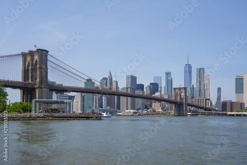 Deurstickers New York City Manhattan skyline and Brooklyn Bridge in daytime