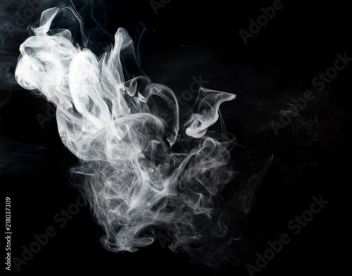 Valokuva  Smoke fragments on a black background