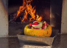 Pumpkin With Apples And Berries Stands Near The Stove