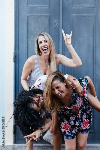 Three girls having fun on the street