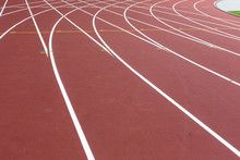 Red Sport Track For Running On Stadium With White Lines. Running Healthy Lifestyle Concept. Sports Background Abstract Texture
