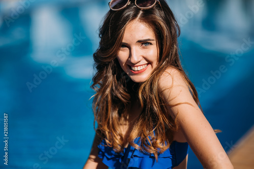 Gypsy Close up fashion portrait of sensual smiling beauty brunette woman posing in swimming pool, relaxing enjoy her summer vacation.hot summer fashion accessory,stylish sunglasses,bikini