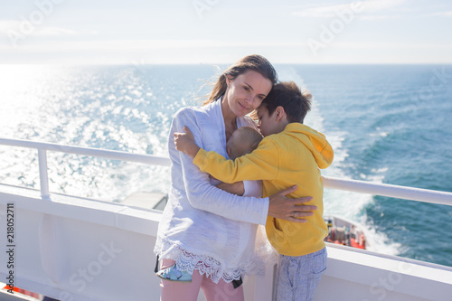 Happy family, traveling on vacation on board of cruise, outdoor on the deck Fototapeta