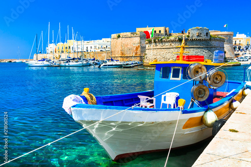 Old port of Gallipoli, view with castle amd boats, Puglia , Italy