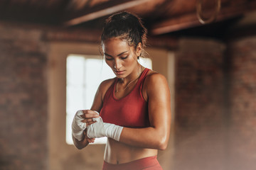 Female boxer wearing strap ...