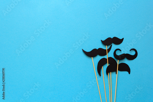 Photo  Paper mustache on booth props on blue paper background