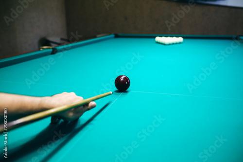 Photo Man is playing billiard
