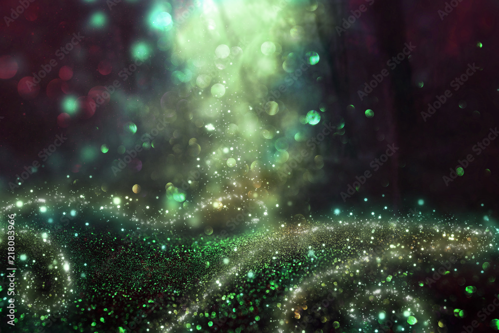 Fototapeta Abstract and magical image of glitter Firefly flying in the night forest. Fairy tale concept.
