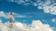 Time - Lapse Video Telecommunication Tower with Moving cloud and blue sky background in technology concept.