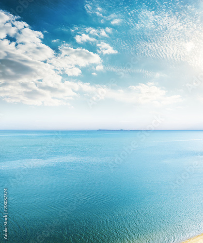 Poster Mer / Ocean aerial view to blue sea and clouds in sunset