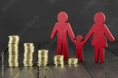 Paper Family and Stacks of Coins Canvas Print