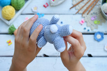 Making Rabbit With Carrot. Crochet Bunny For Child. On Table Threads, Needles, Hook, Cotton Yarn. Step 2 - To Sew All Details Of Toy. Handmade Crafts. DIY Concept. Small Business. Income From Hobby.