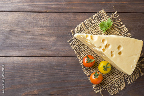 Recess Fitting Dairy products Cheese and tomatoes on dark wooden background with copy space