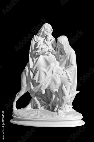 statuette of a religious scene with a baby Jesus