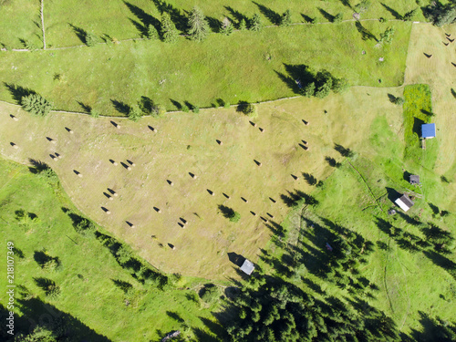 Foto op Canvas Pistache aerial view of garden with hay stacks in Romania, countryside