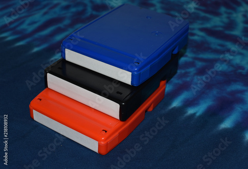 Fotografija  Colorful 8 track tapes on blue background
