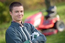 Portrait Of Young Man, Mower In Background